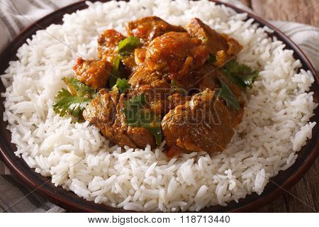 Indian Cuisine: Beef Madras With Basmati Rice Close-up. Horizontal