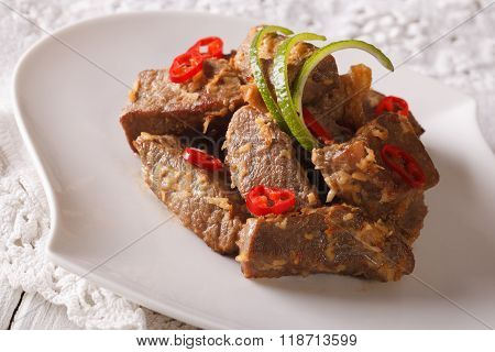 Beef Rendang Stewed In Coconut Milk With Spices Close-up. Horizontal