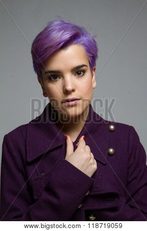 Violet-short-haired Girl Wearing A Violet Coat, Looking At Camera.