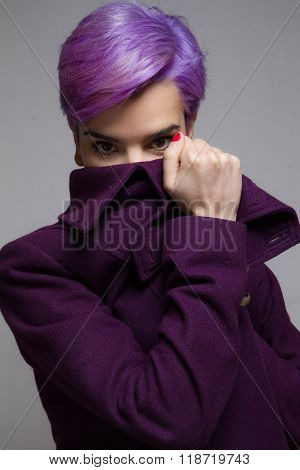 Violet Short-haired Woman Peeking Behind A Violet Coat.
