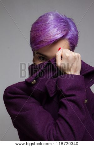 Violet Short-haired Woman Peeking Through One Eye, Behind A Violet Coat.