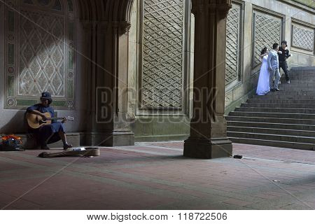 Black Girl Sings And Plays Guitar Under Bethesda Arcade In New York City Central Park While Photogra