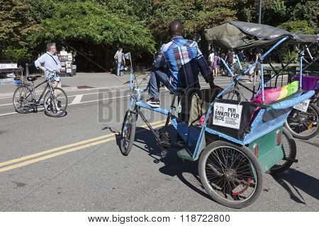 Man On Taxi Bike Waits For Clients In Central Park New York