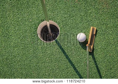 Putter With Golf Ball And Hole