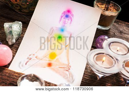 Chakras illustrated over human body with natural crystals