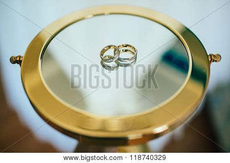 Wedding rings on the mirror