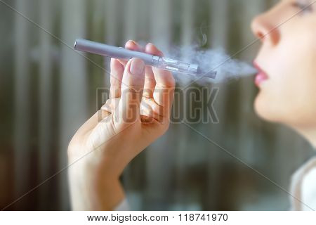 Closeup Portrait Of Female Smokers.
