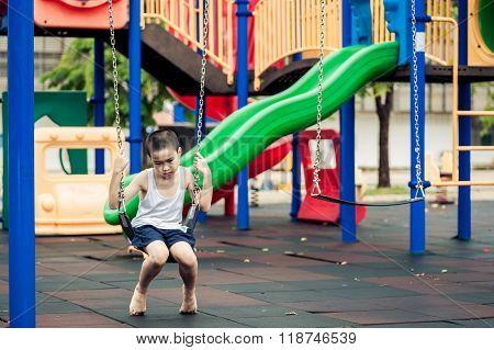 Sad Boy At Playground