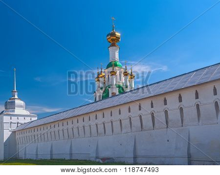 White  Ortodox Monastery With Gold Domesl In Sunny Spring Day