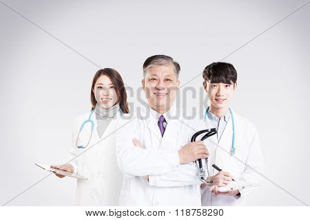old Asian man doctor with young beautiful woman doctor and young man doctor