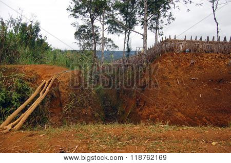 Village Ditch With Timber Fence At Rural Area