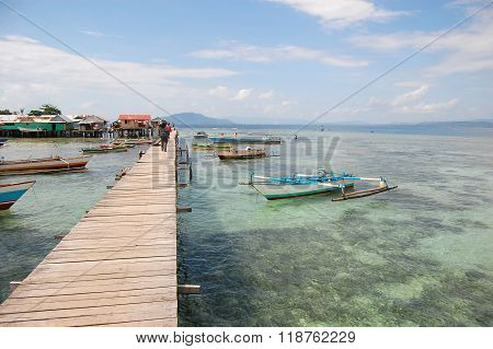 Boats Near Long Village Timber Pier