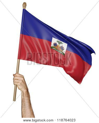 Hand proudly waving the national flag of Haiti