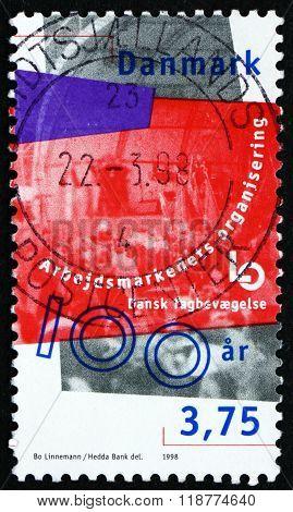 DENMARK - CIRCA 1998: a stamp printed in Denmark dedicated to Danish Confederation of Trade Unions Centenary circa 2000
