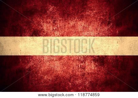 flag of Latvia or Latvian banner on rough pattern texture vintage background poster