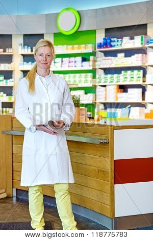 Cute Pharmacist Standing Near Counter