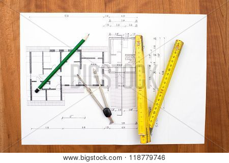 Building Plan With Pencil, Folding Yardstick And Compass