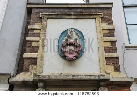 Upper Part Of Art Decoration Of The Antique House On Jansstraat Street In The Historic Centre Of Haa