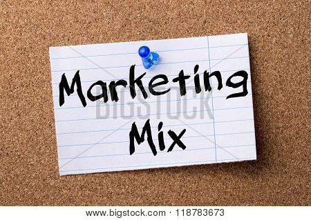 Marketing Mix - Teared Note Paper Pinned On Bulletin Board