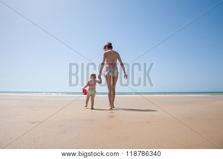 Back Mother And Baby With Bucket In Seashore