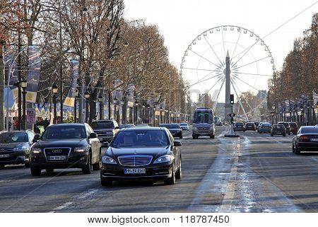 Paris, France -18 December 2011: Avenue Champs-elysees With Ferris Wheel At Horizon In Paris, France