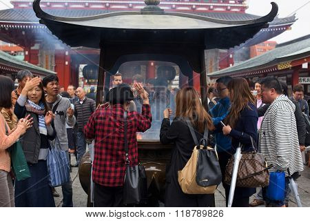 People Fan Incense Smoke At Sensoji Temple