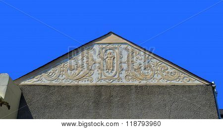 Ornate plasterwork on the gable end of a house in Wale
