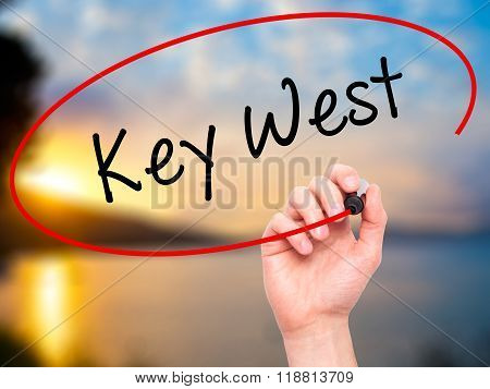 Man Hand Writing Key West With Black Marker On Visual Screen