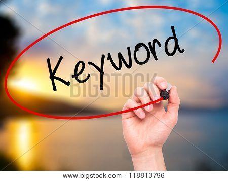 Man Hand Writing Keyword With Black Marker On Visual Screen