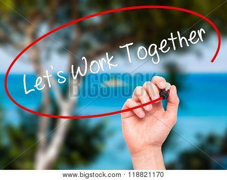 Man Hand Writing Lets Work Together With Black Marker On Visual Screen