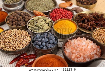 Aromatic spices in metal bowls. Food ingredients.