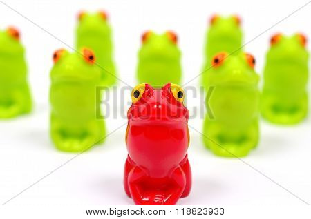Small plastic toy frogs.