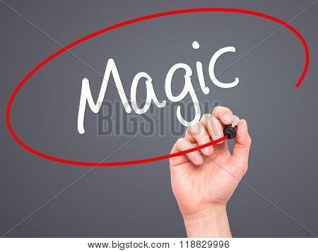 Man Hand Writing Magic With Black Marker On Visual Screen