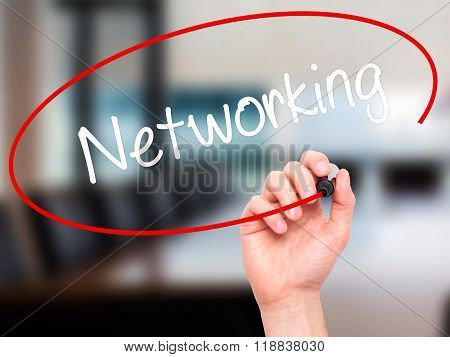 Man Hand Writing Networking With Black Marker On Visual Screen