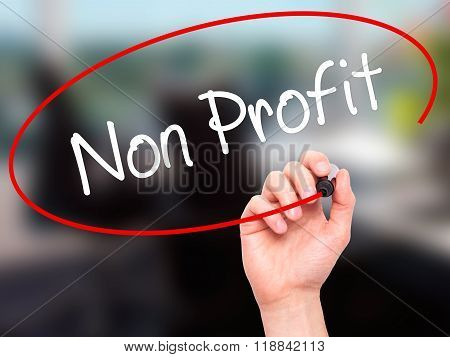 Man Hand Writing Non Profit With Black Marker On Visual Screen