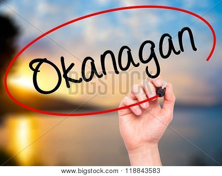 Man Hand Writing  Okanagan With Black Marker On Visual Screen