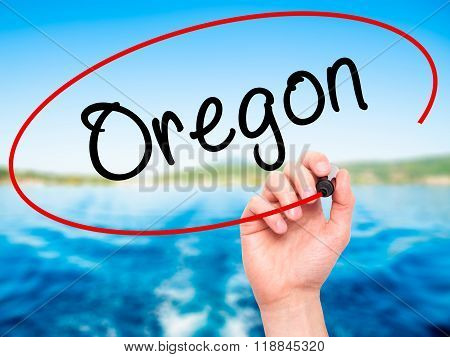 Man Hand Writing Oregon With Black Marker On Visual Screen