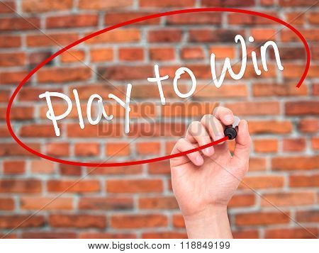 Man Hand Writing Play To Win With Black Marker On Visual Screen