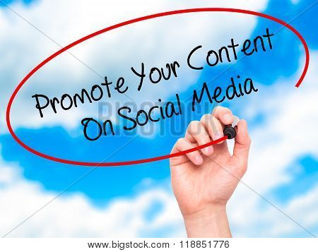 Man Hand Writing Promote Your Content On Social Media  With Black Marker On Visual Screen