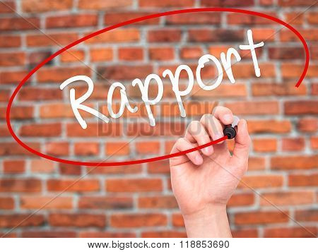 Man Hand Writing Rapport With Black Marker On Visual Screen