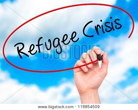 Man Hand Writing Refugee Crisis With Black Marker On Visual Screen
