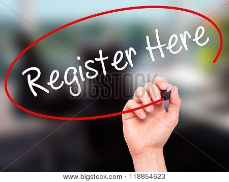 Man Hand Writing Register Here With Black Marker On Visual Screen