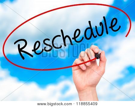 Man Hand Writing Reschedule  With Black Marker On Visual Screen