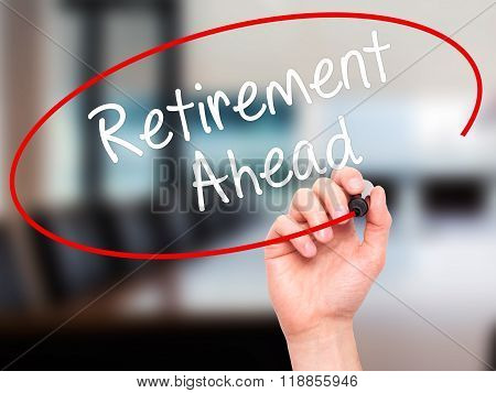 Man Hand Writing Retirement Ahead With Black Marker On Visual Screen