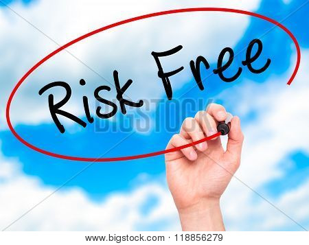 Man Hand Writing Risk Free With Black Marker On Visual Screen