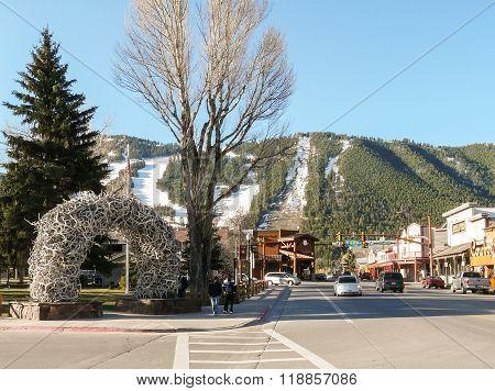 Streets Of Jackson Hole With Ski Slopes At Background