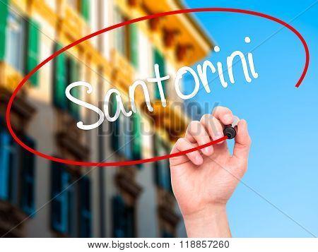Man Hand Writing Santorini  With Black Marker On Visual Screen