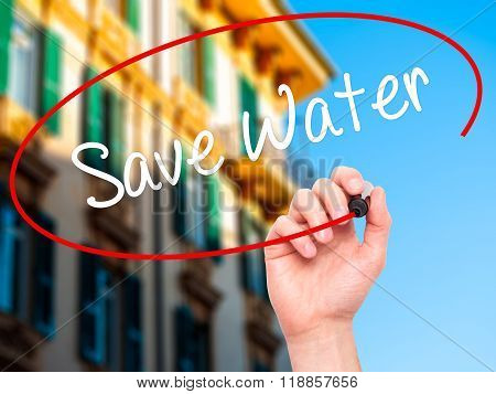 Man Hand Writing Save Water  With Black Marker On Visual Screen