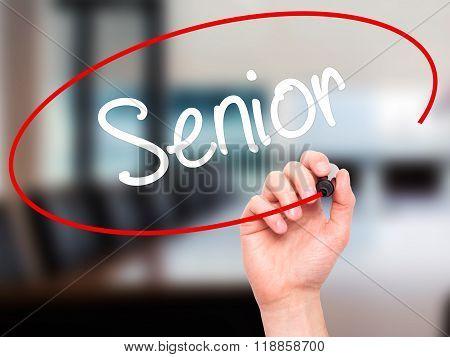 Man Hand Writing Senior With Black Marker On Visual Screen