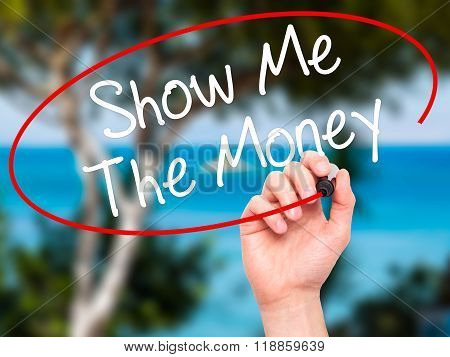 Man Hand Writing Show Me The Money With Black Marker On Visual Screen